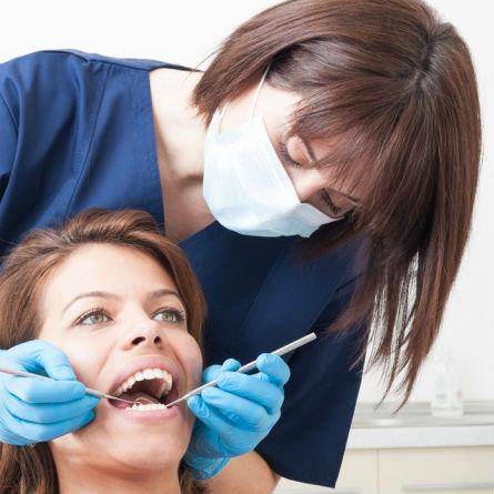 Dental hygiene student receives practical training.